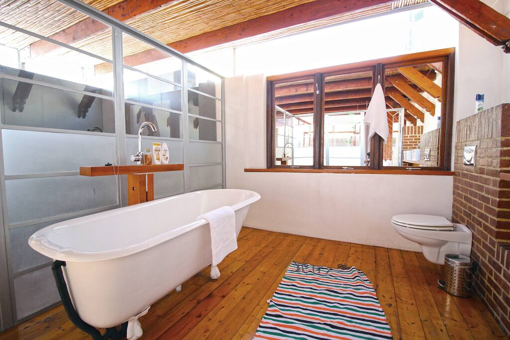 Master bedroom bathroom with victorian bath and double sink