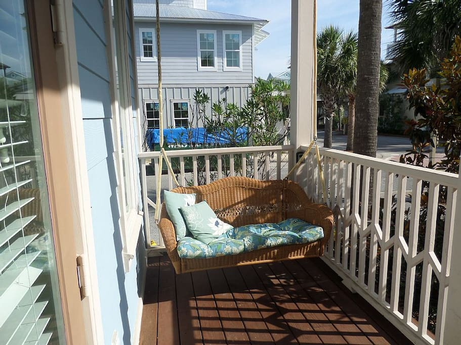 One of 6 porches, so cozy you will relax to the sound of the gulf