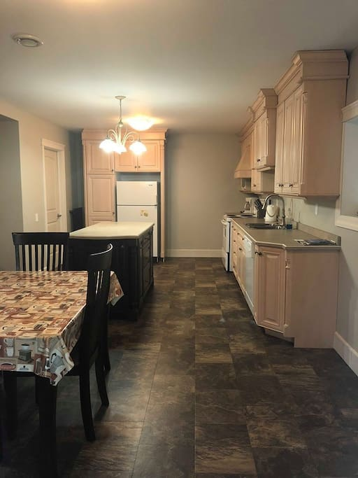 Modern style kitchen with beautiful cabinets and a large island. Fully equipped with everything you could need to prepare meals.