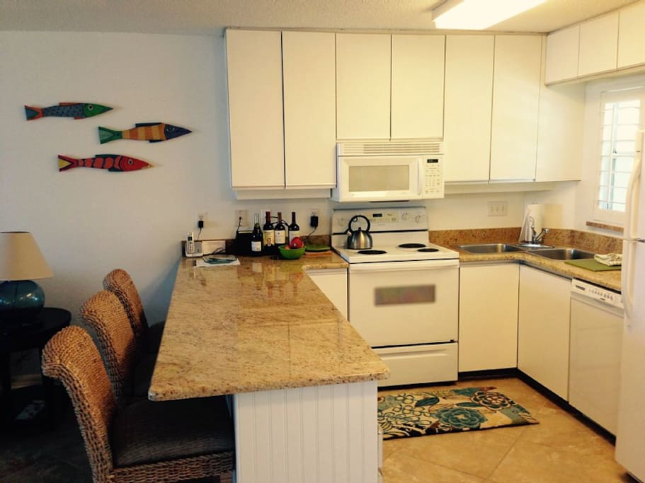 Fully stocked kitchen with outside grilling available.
