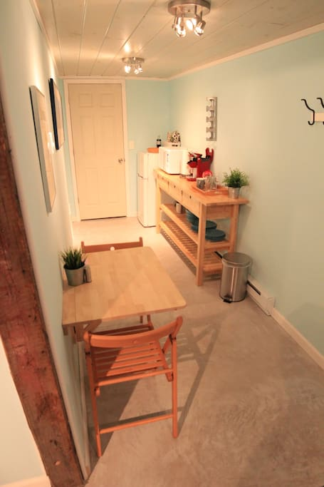 Creative galley kitchen area w/ dining table for two that folds down and leading to a full walk-in closet.