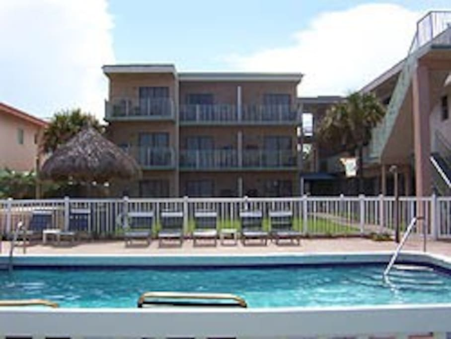 This shows the proximity of the beachfront pool.  A BBQ and gazebo are between the pool and the unit.