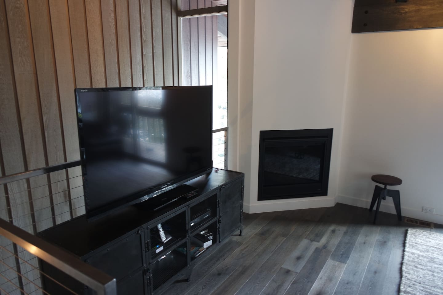 "Living room with 65"" TV & remote controlled gas fireplace."