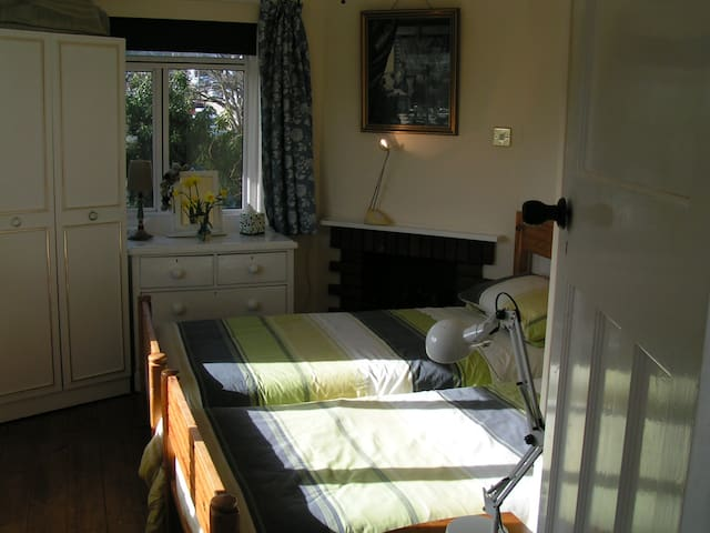Small room, single or twin beds,  share bathroom .