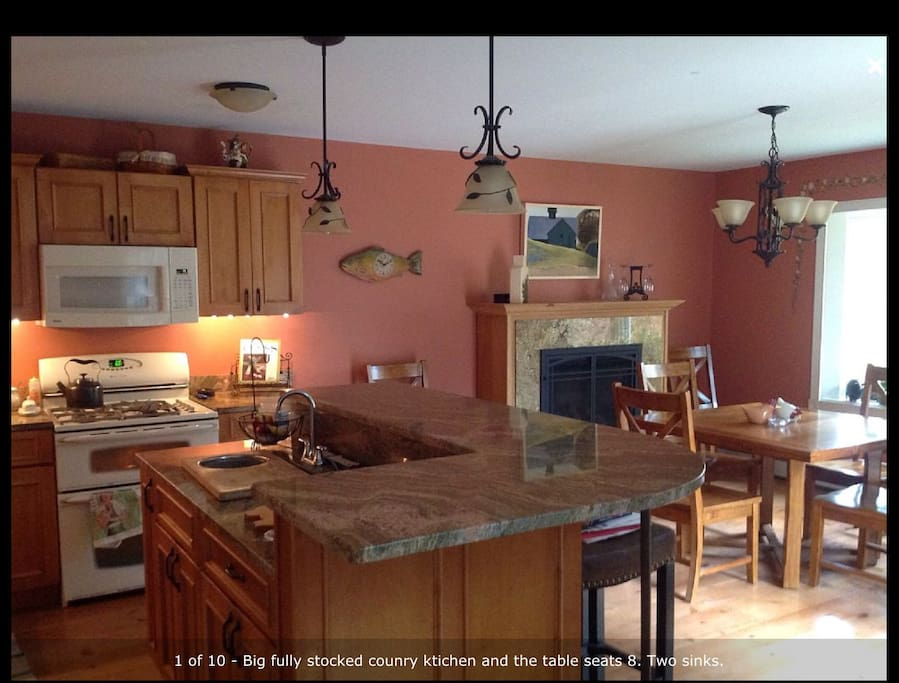 Fully stocked kitchen with round table that seats 8 and counter that seats 3. Gas fireplace for cozy meals.