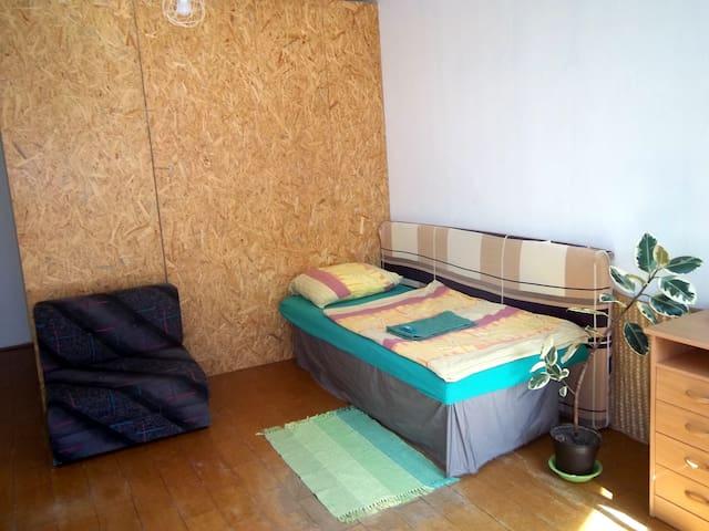 A simple green room in České Budějovice