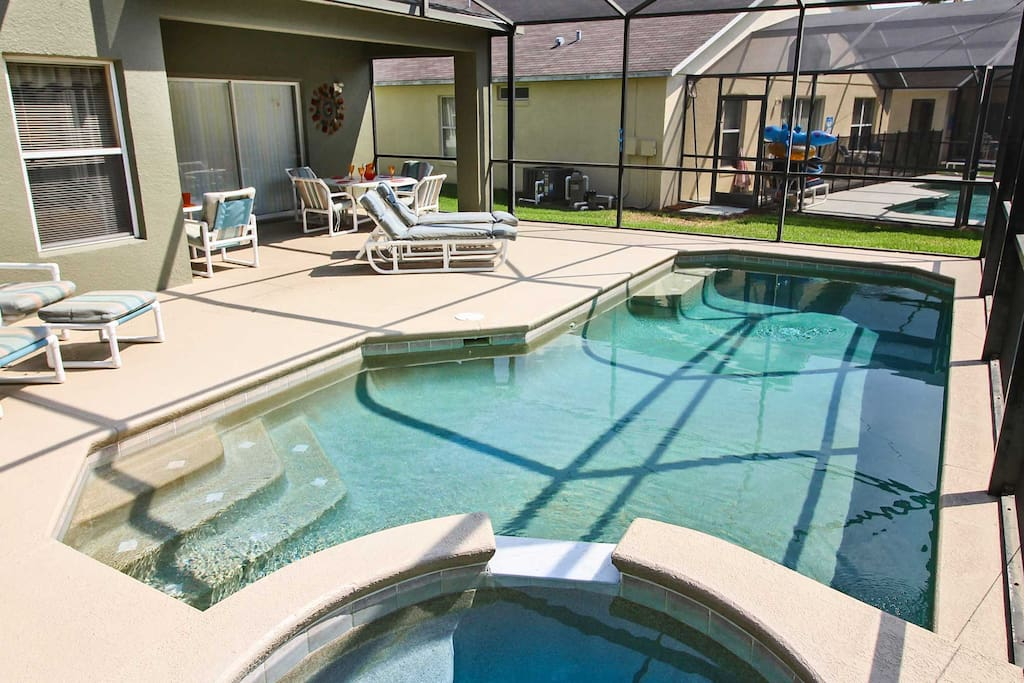 Complete with a screened-in patio and pool, this home provides the perfect place to enjoy the outdoors.