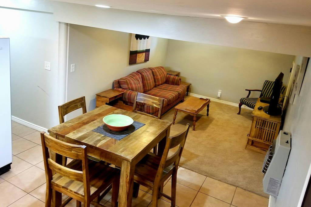 Nice dinning table for four and cozy living room!