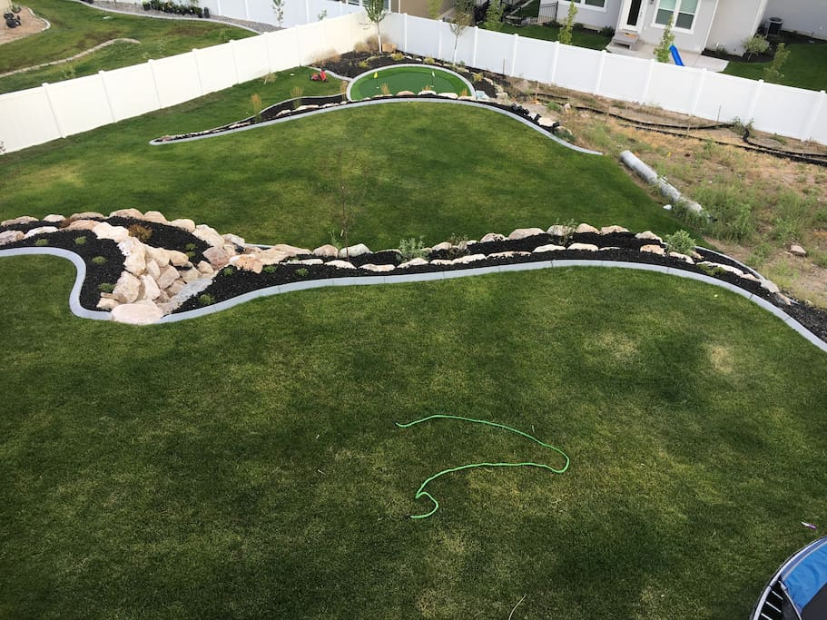 Big yard to play in with in ground tramp and putting green.