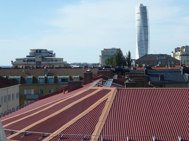 View from the kitchen. Turning Torso at the right. And a glimp of the sea.