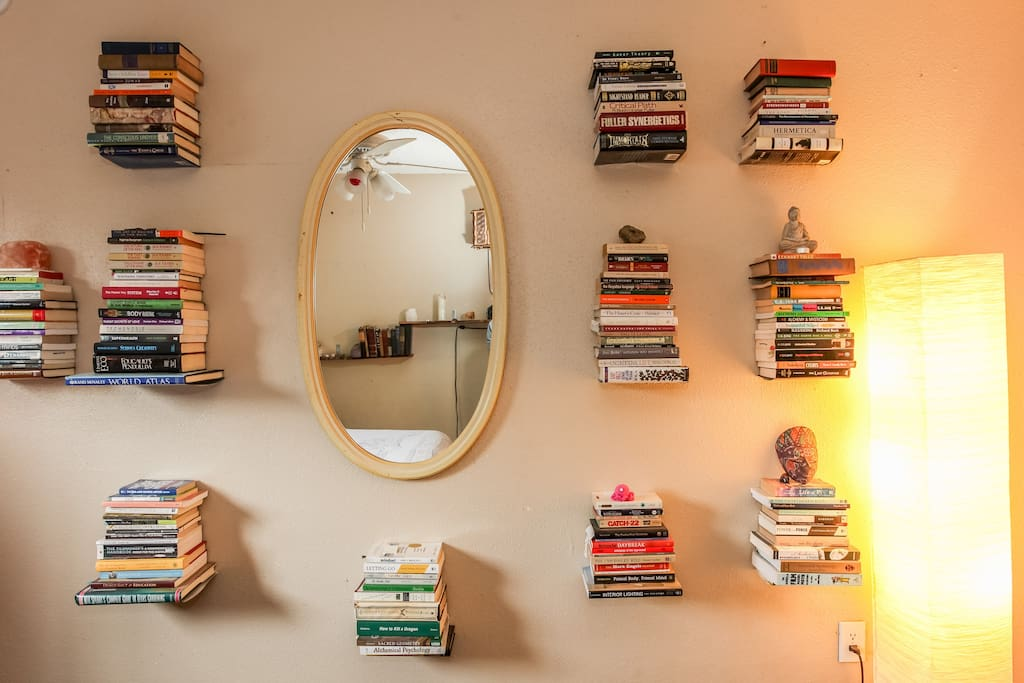 Personal growth library on the wall.