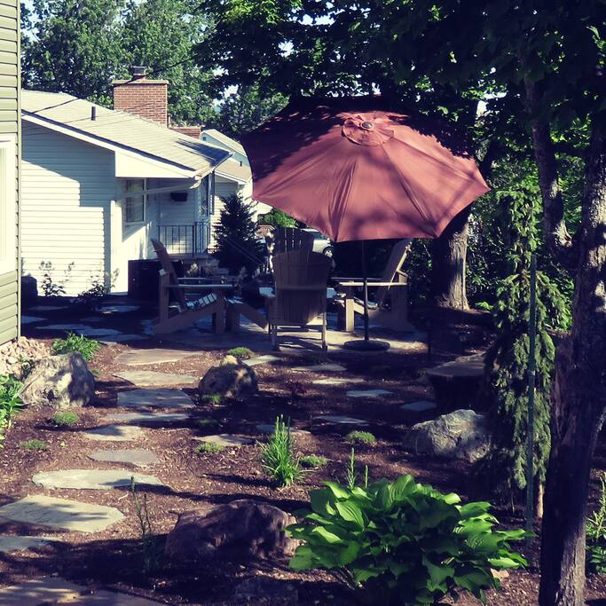 Looking North, the rock garden patio with the umbrella extended.