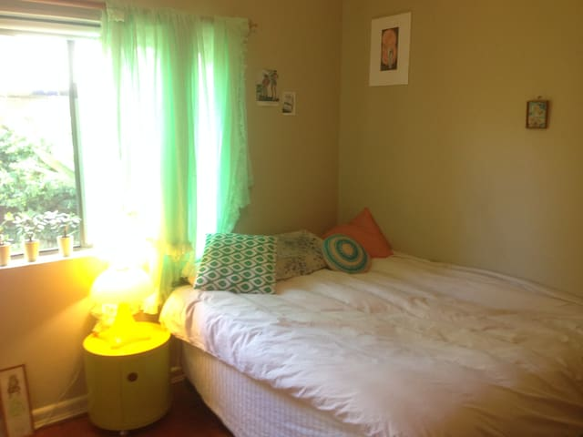Large light-filled room in friendly sharehouse