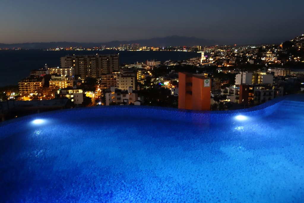 Pool and city view at night.