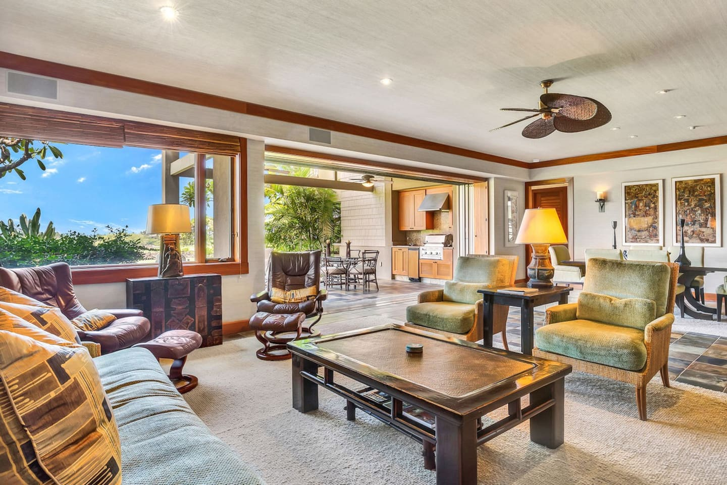 Spacious living area with view to dining area and lanai.