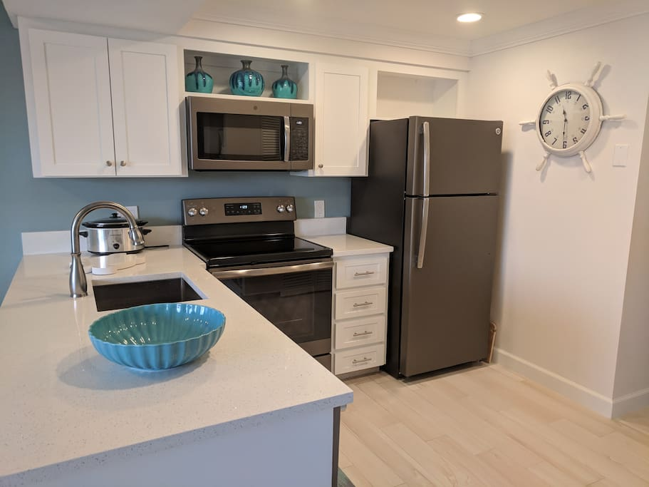 Kitchen with brand new appliances, countertops and floors.