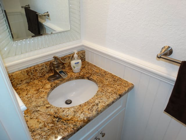 Half Bath features Granite and remodeled cabinetry!