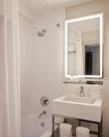 Our bathrooms feature multi-setting shower heads with bath towels and signature toiletries by PURE.
