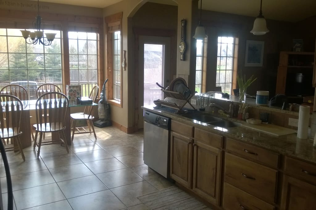 Kitchen with range, microwave, dishwasher stove and large pantry