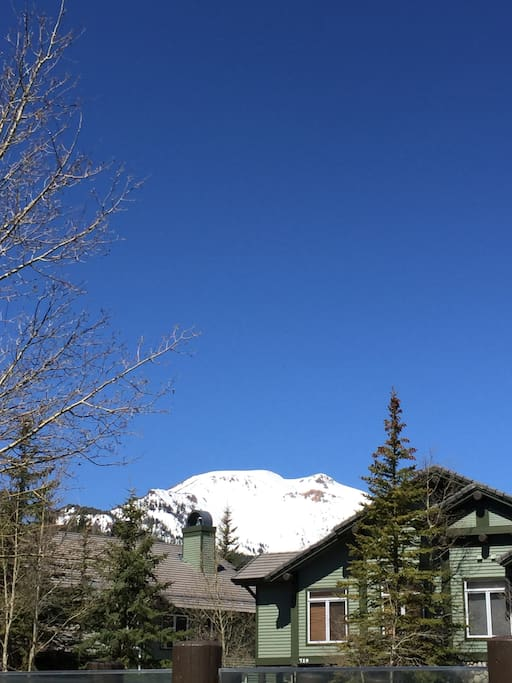 View of Mammoth Mountain from the deck (more green trees in summer/spring)