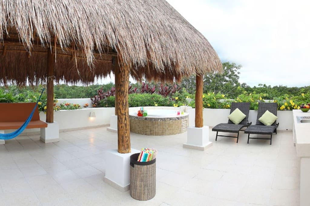 Take a break from the sun under the shade of the palapa