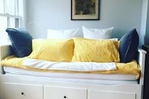 Daybed pulls out to a full/queen, very comfortable, great linens, soft Egyptian cotton; both firm and soft pillows!