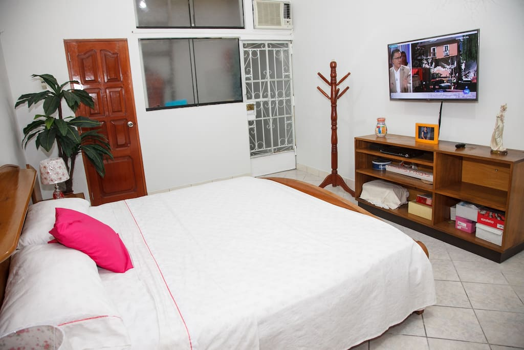 Spacious main bedroom with Cable TV and air conditioning.