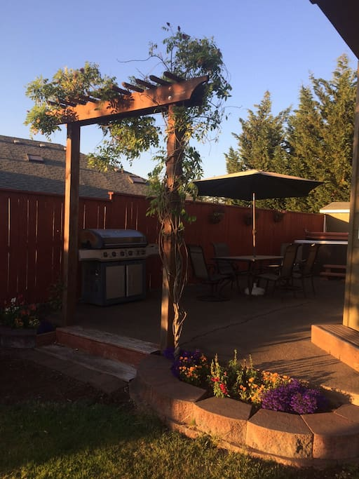 Patio for grilling and hot tubing.
