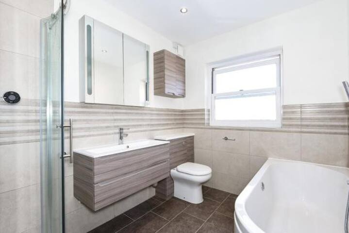 Luxury bath and shower room, with Australian Bodycare shower gel provided.