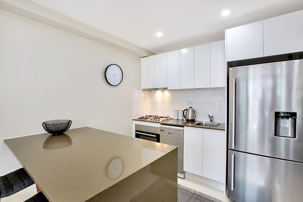 Modern kitchen with gas cooktop and dishwasher