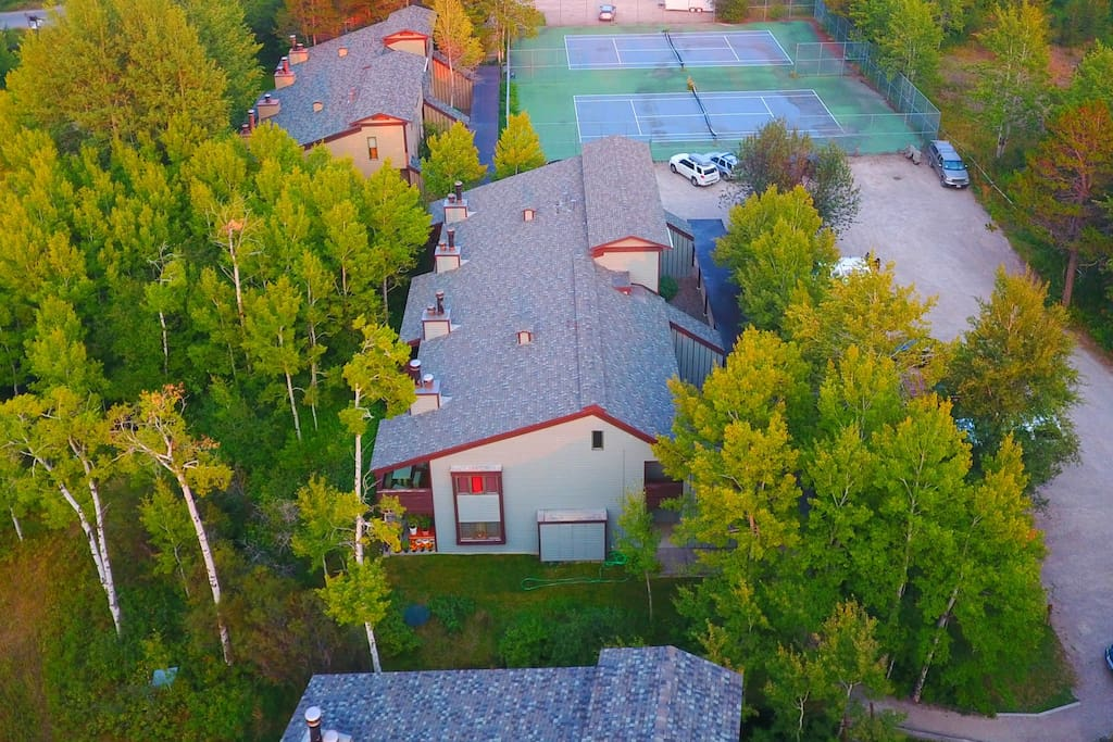 An aerial view of the condo shows the beautiful views of surrounding trees and greenery. You'll feel like you're in a cabin in the woods! It's not uncommon to see moose and other wildlife in and around the property!