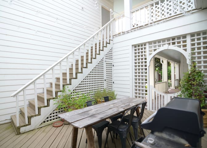 Private entry deck with shared BBQ grill.