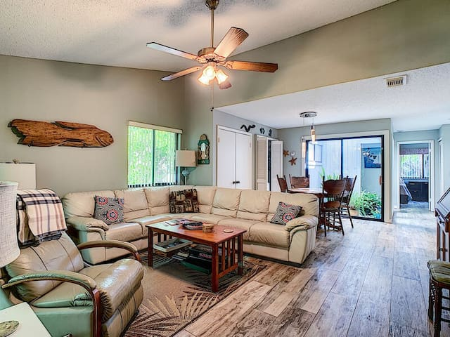The living room also offers access to the patio.