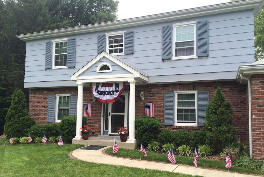 House adorned with flags for Memorial Day and 4th of July.