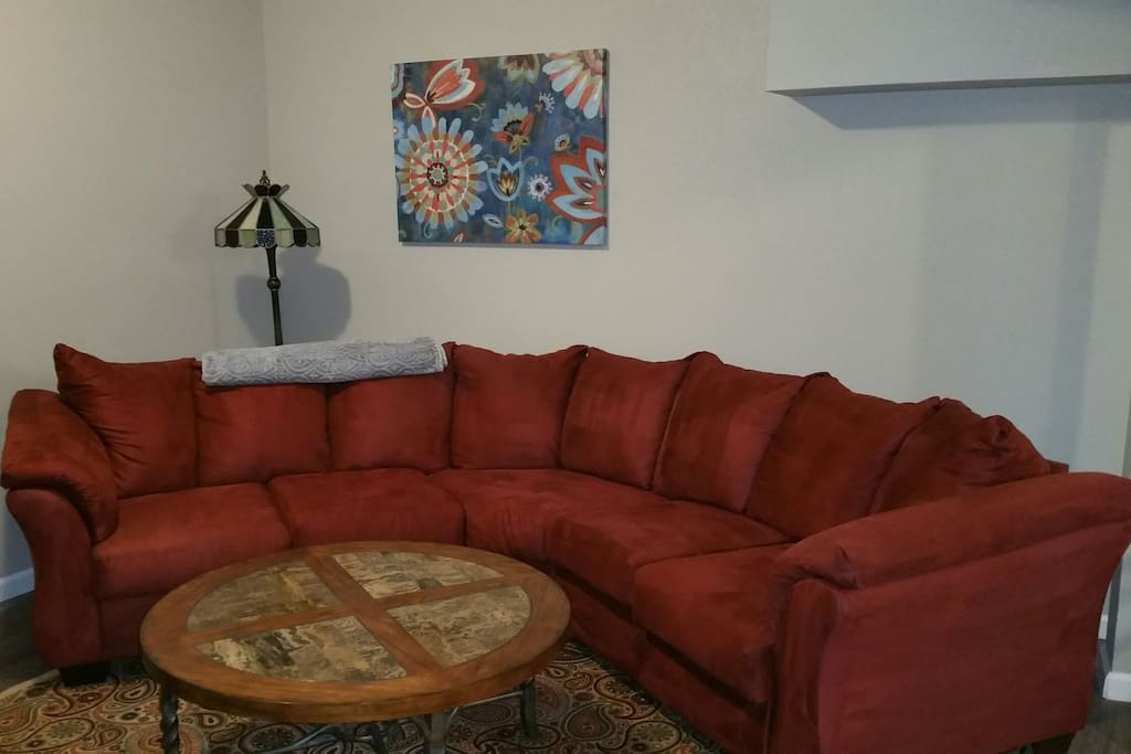 Living room with curved sectional sofa