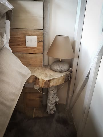 handmade toadstool bedside tables and handmade pottery lampbase by Siobhan's mother