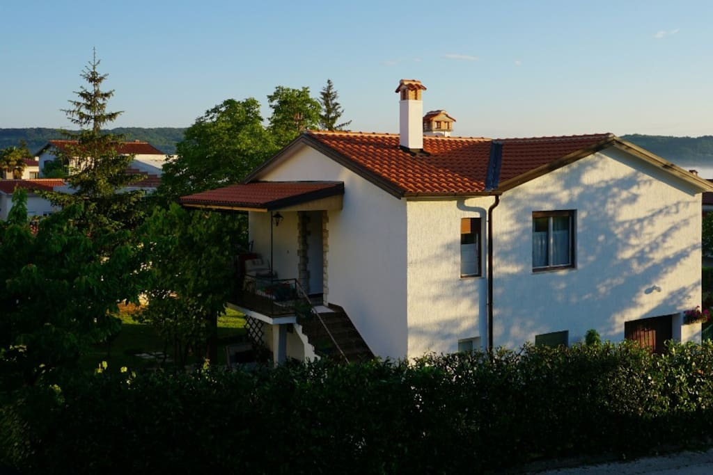 view of the house (the apartment is located on the ground floor below the terrace)