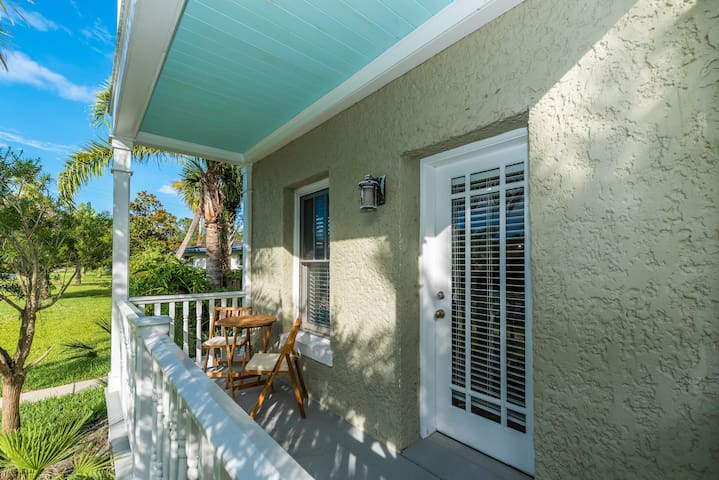 Front porch with bistro dining set to sit at while sipping on your morning coffee