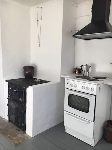 The kitchen with the wooden stove.