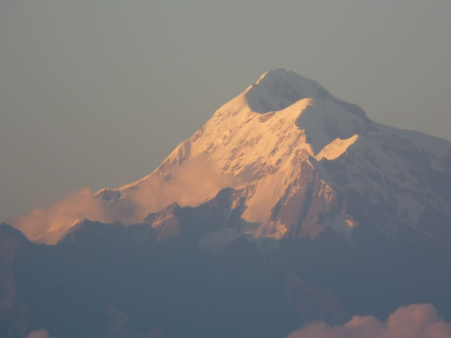 The TRISHUL peak with the three prongs outlined by the evening light