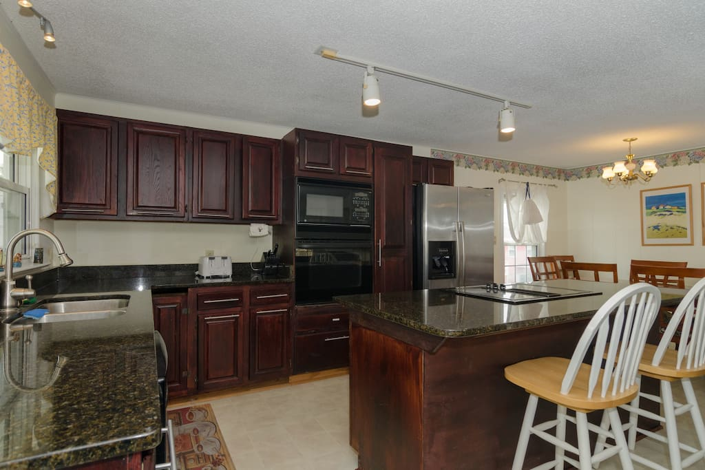 Kitchen with bar seating for two.