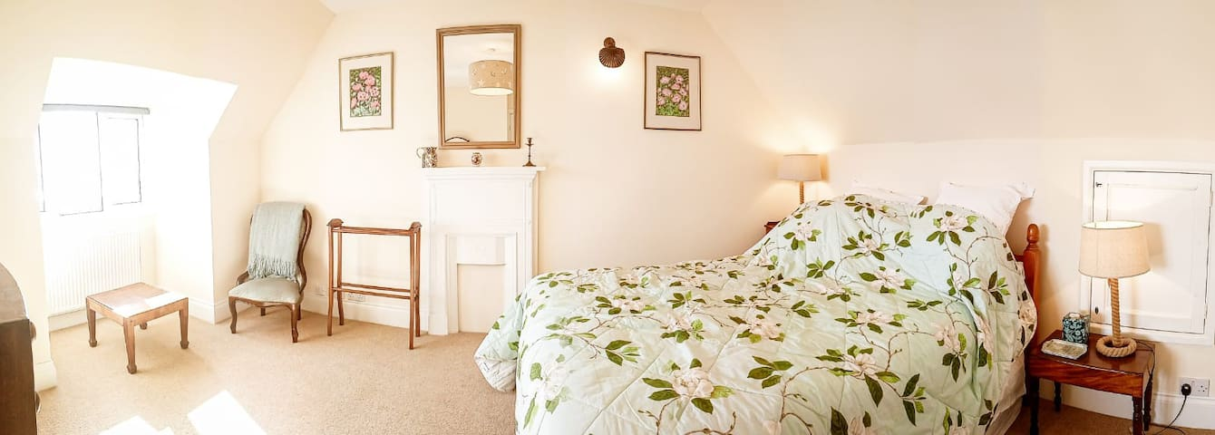 Bedroom with king size bed and views across the water to the village of Appledore