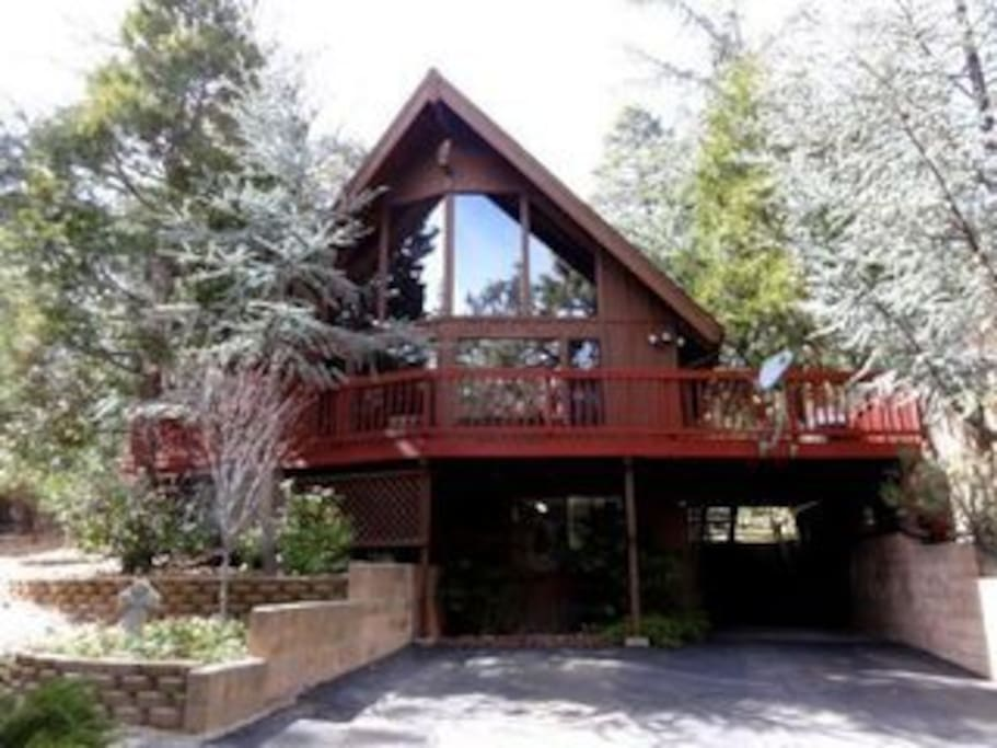 Enjoy stunning views from the cathedral windows. Wrap around deck gets full sun and has a jacuuzi