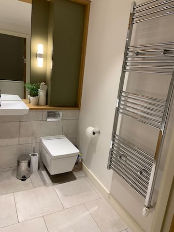 Crisp clean bathroom, only shared with one other room.  Regularly inspected for cleanliness