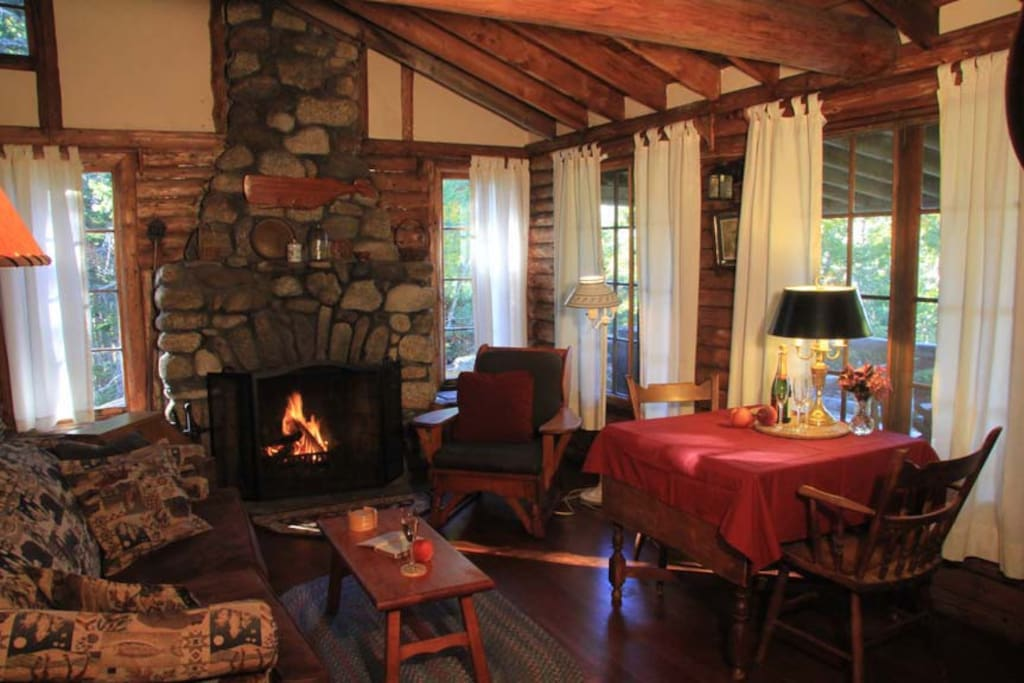 """In true """"old Maine"""" style Crow's Nest has open rafters. It's a real log style cottage with plenty of vintage character, but modern comforts and """"country wifi."""" The sofa has a hide-a-bed."""