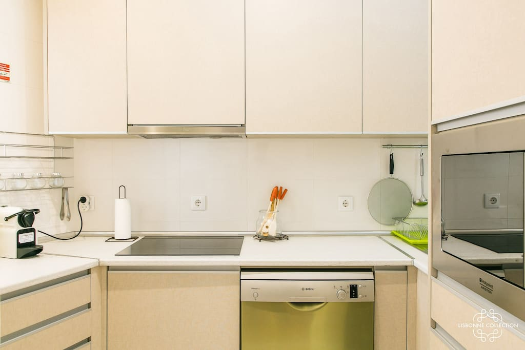 Fully equipped kitchen with nespresso coffee machine, washing machine, hot plates, microwaves, kettle , fridge