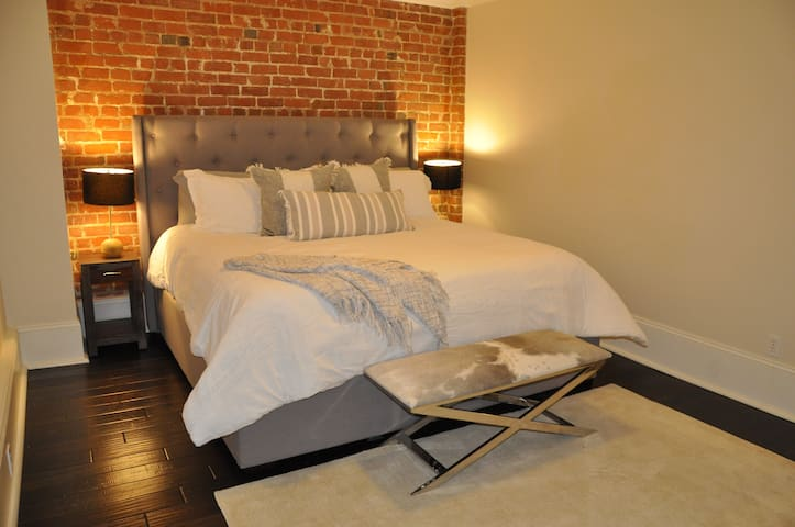 King Size Bed with exposed Brick walls