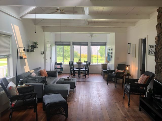 The main room offers space to relax, play cards, read and visit with those closest to you.  Open the screened windows for the MB island breeze that grew world-famous grapes throughout her history.