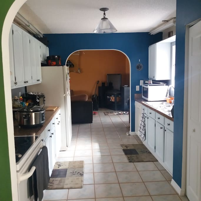 Galley kitchen and entertainment space