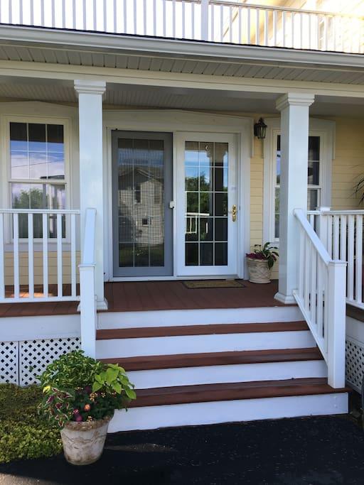 Private entrance on wraparound porch.